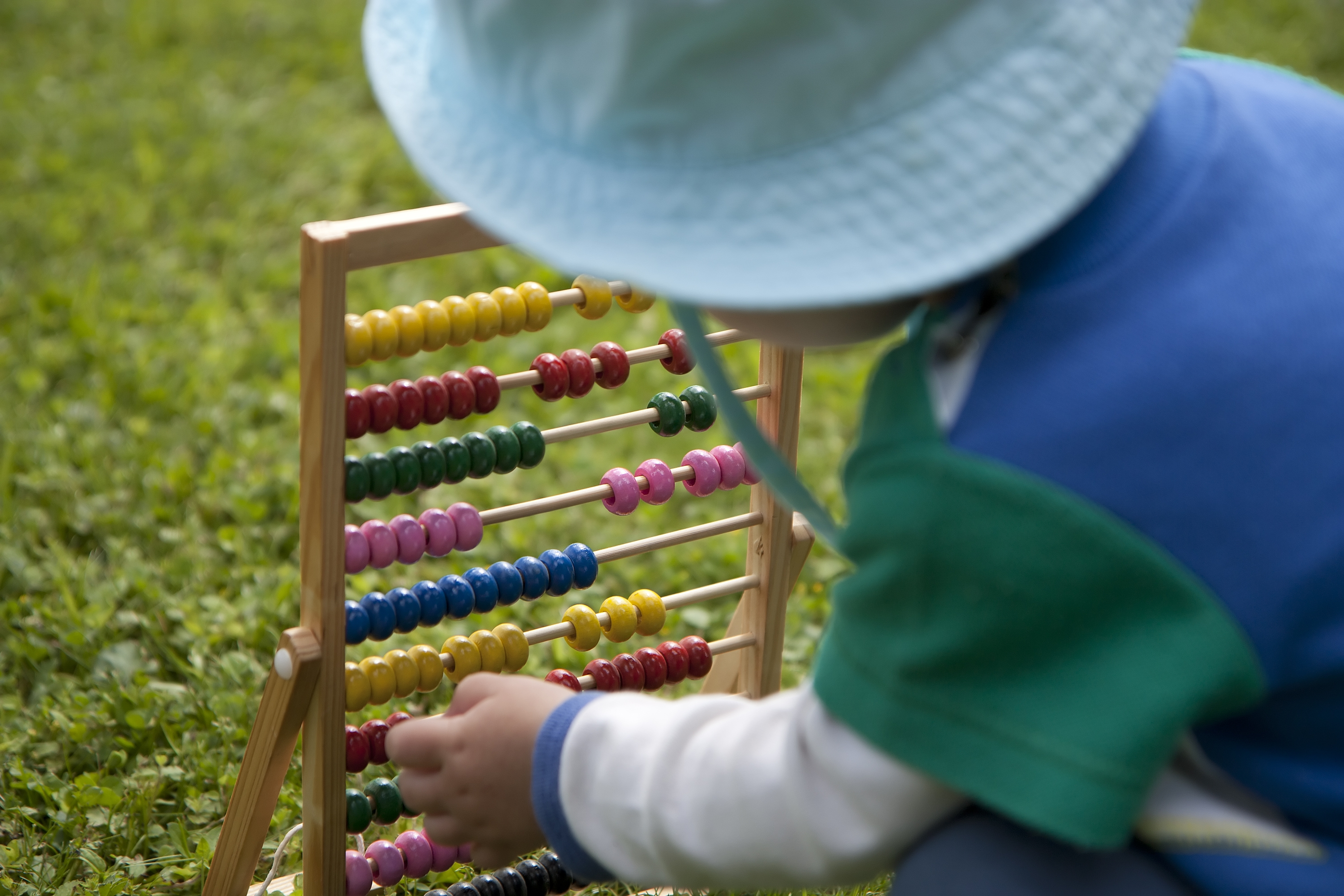 Little kid with abacus